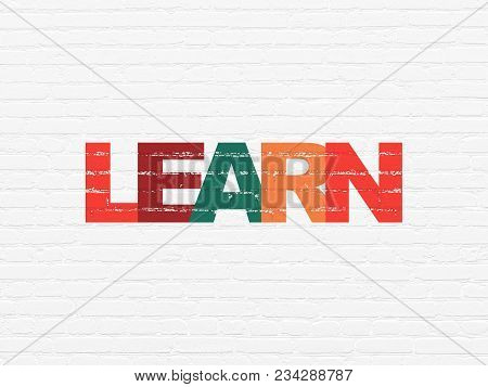 Learning Concept: Painted Multicolor Text Learn On White Brick Wall Background