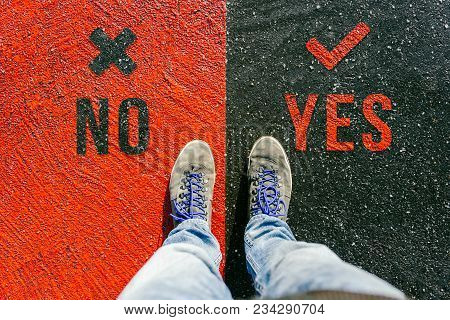 Reaching A Crossroads Having To Decide About No And Yes About Future Symbolized By Two Feet Standing