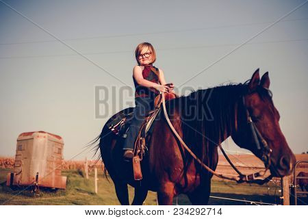 Young girl is enjoying a horse riding