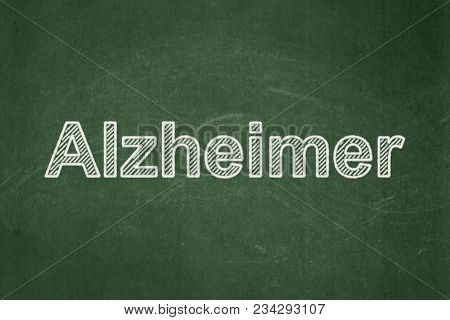 Health Concept: Text Alzheimer On Green Chalkboard Background