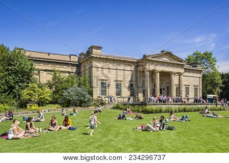 31 May 2017: York, North Yorkshire, England, Uk - People Of All Ages Relaxing On A Sunny Day In The