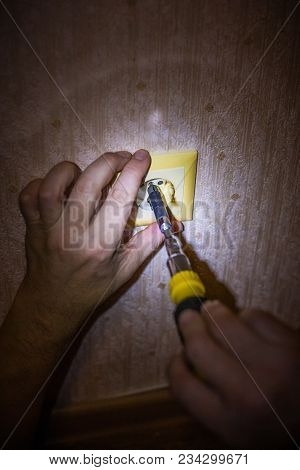 Electrician Repairing Socket On Light Wall. Repair Electricity Socket Man With Bare Hands. Incorrect