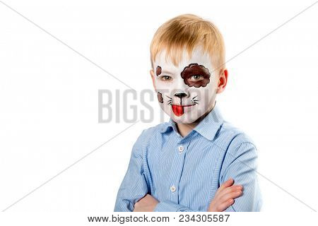 Boy with face painting as a dog