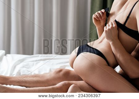 Couple Having Sex In The Bedroom. Foreplay In Bed While Lying On Bed.