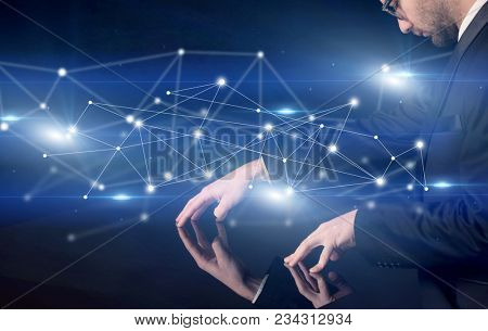 Male hands touching interactive table with blue connectivity graphic in the background poster