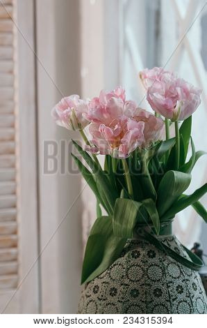 A Soft Focused Bouquet Of Pink Peony Tulips In An Old Big Vase On A Window Sill, Light Wooden Jalous