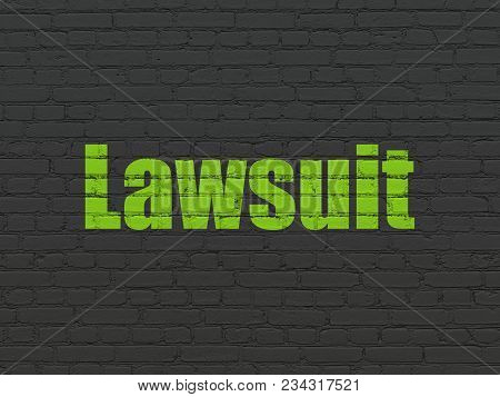 Law Concept: Painted Green Text Lawsuit On Black Brick Wall Background