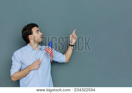 American Citizen. Pleasant Nice Happy Man Holding The Us Flag And Looking In The Direction Of His Ha