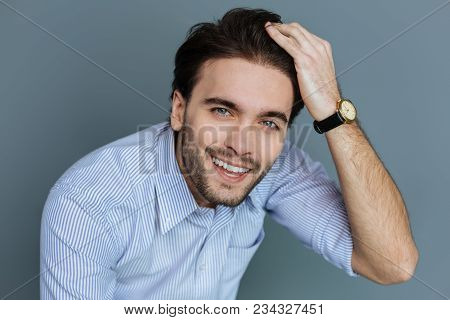 Handsome Look. Portrait Of A Nice Happy Positive Man Touching His Hair And Looking At You While Feel