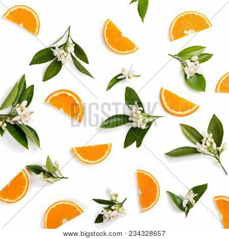 Top View Of Blossoming Branches Of Orange Tree With Leaves And Sliced Orange Fruit, Isolated On Whit