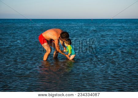 Father And His Toddler Daughter Having Quality Time Together At Sea. Summer Vacation, Fatherhood Con