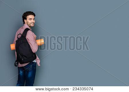 Walking Tour. Joyful Handsome Young Man Wearing A Rucksack And Smiling To You While Having A Walking