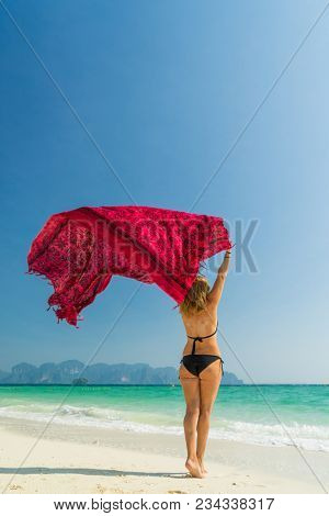 Woman with pink sarong on the tropical beach, Luxury beach travel vacation  poster