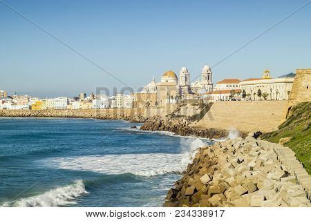 Atlantic Ocean Shore And City Center With Cathedral Of Cadiz, Andalusia, Spain