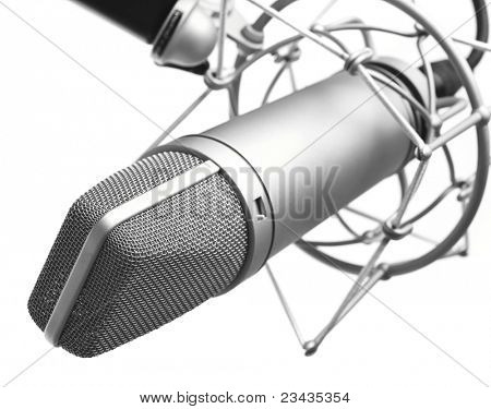 closeup of vintage microphone on white background
