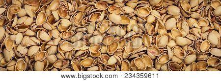 Pistachio Shells. Empty Pistachio Nut Shell. Panoramic Image. Selective Focus.