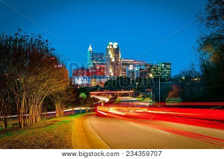 A beautiful downtown cityscape view of Raleigh, North Carolina with dynamic light trails.