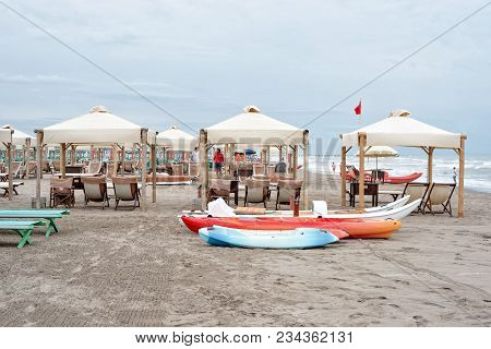 Forte Dei Marmi, Italy - June 30, 2017: Daylight View To Parked Boats On Sand And People Talking On