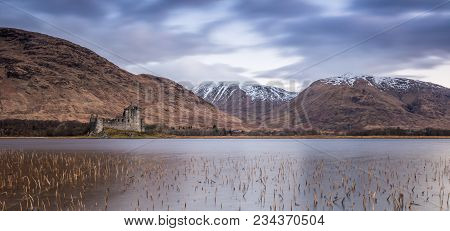 Kilchurn Castle, Built In The 15th Century, Is A Ruined Structure At The Northeastern End Of Loch Aw