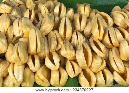Pile Of Fresh Sweet Yellow Jack Fruit On Green Banana Leaf, Traditional Asian Fruit
