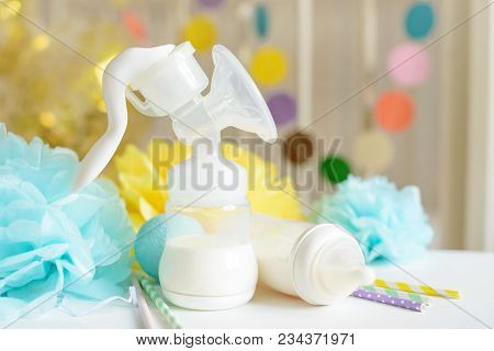 Baby Bottle With Breast Milk, Various Festive Paper Decor In Front Of Baby Bed. It's A Boy Or Baby B