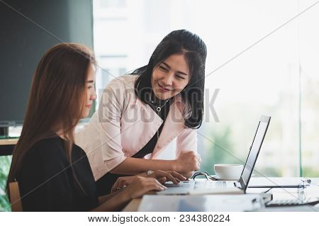 Young Asian Business Workers Working Together With Laptop Computer In Office. Business Startup Teamw