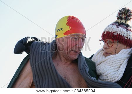 ST. PETERSBURG, RUSSIA - MARCH 4, 2018: 80 years old Richard Buche from Belgium after winter swimming competitions for Big Neva Cup. Winter swimmers from 12 countries take part in the competitions