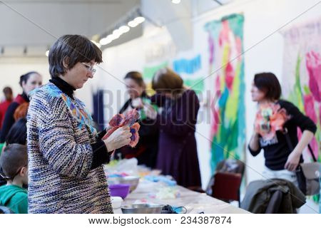 SAINT-PETERSBURG, RUSSIA - MARCH 22, 2018: Visitor on the exhibition Craft Bazaar during TeddyFun 2018. The exhibition is held seasonally since 2011