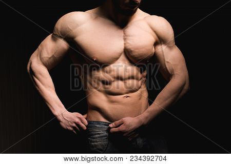 Portrait Of Shirtless Muscular Man In A Jeans. Young Male Hunk Showing His Perfect Body And Muscles