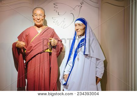 Prague, Czech Republic - May 2017: The Wax Figures Dalai Lama And Mother Teresa In The Madame Tussau