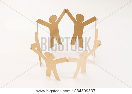 Closed Joining Of Six  Brown Paper Figure In Hand Up Posture On Bright White Background. In Concept