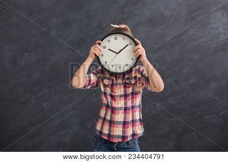 Little Girl Holding Big Clock, Covering Her Face. Time Management, Deadline, Time To Study, School C