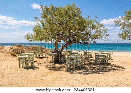 Romantic Greek Tavern On The Plaka Beach. Naxos Island, Greece.