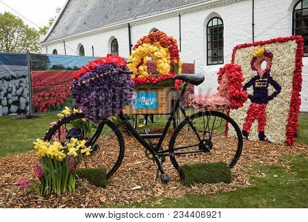 Noordwijkerhout, Netherlands - April 21,  2017: Bicycles Decorated With Flowers At The Traditional F