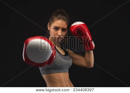 Gorgeous Young Woman With Boxing Gloves And Standing In Position, Ready To Fight. Mockup, Copy Space