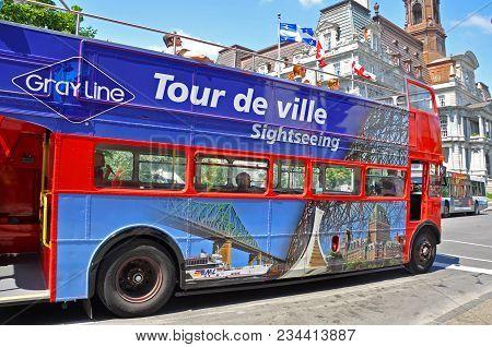 Montreal - Aug. 4, 2011: British Style Double-decker Tour Bus Tour De Ville In Front Of City Hall Of