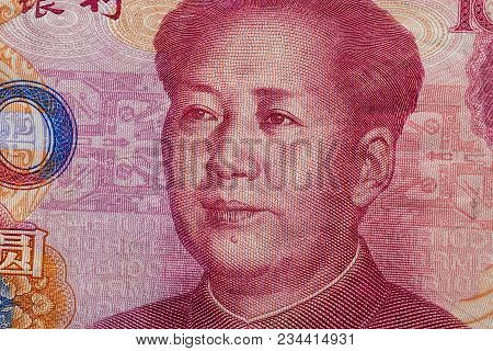 Close Up Of One Hundred Yuan Banknote With Focus On Portrait Of Chinese Statesman Mao Tse-tung