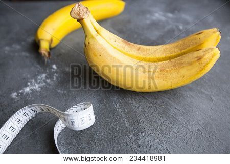 Healthy Breakfast, Sport, Fitness, Weight Loss, Diet Concept. Keeping Fit With Bananas And Tape-meas
