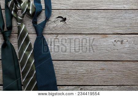 Set Of Stylish Men On Rustic Wood Background