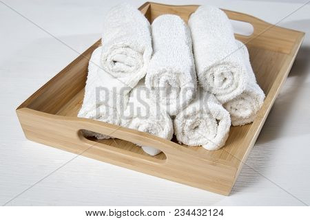 White Spa Towels Pile In Tray Isolated On White Background