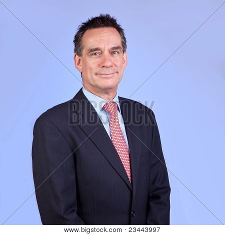 Attractive Smiling Business Man in Suit