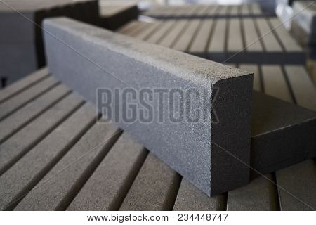 Paving Slabs Factory. Tiles Piled In Pallets. Warehouse Paving Slabs In The Factory For Its Producti