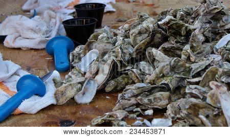 Horizontal Oyster Roast Table With Knives And Towels