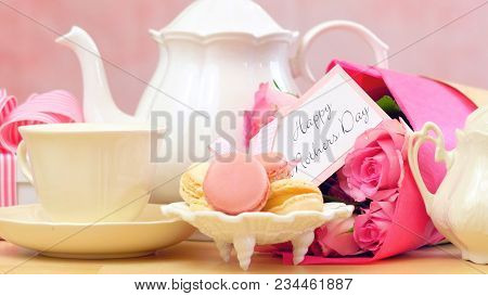 Mother's Day Tea Setting With Macaron Cookies, Pink Roses And Gift, Closeup.