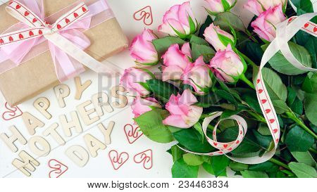 Mother's Day Overhead With Gift And Pink Roses On White Wood Table Background