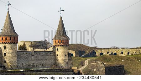Kamianets Podilskyi Fortress Built In The 14th Century. View Of The  Fortress Wall With Towers At Ea
