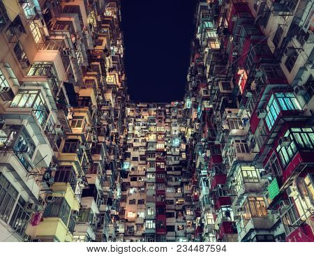 Hong Kong - October 2017: Residential building in densely populated area at night.