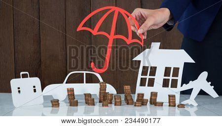 Cut outs of umbrella against wood
