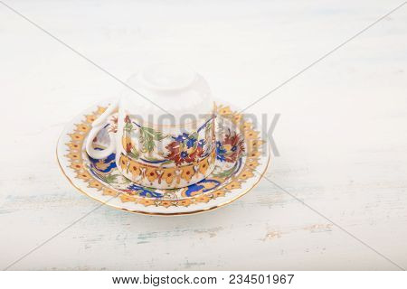 Upside Down Vintage Turkish Coffee Cup Over Saucer Traditionally Using For Fortune Telling On Wooden