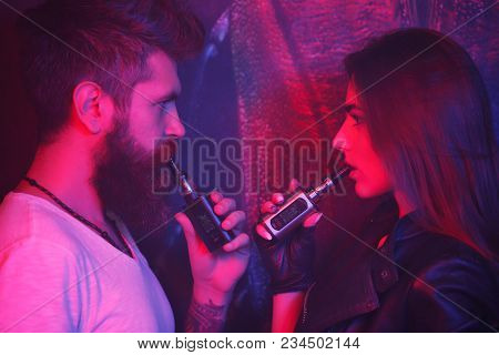 Concept Of Smoking In Public Places Is Steam And Smoke. Bearded Man And Girl Posing On Camera And Sm